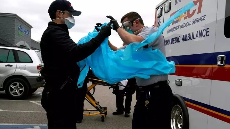 paramedics-put-on-protective-gear-before-making-contact-with-a-potential-coronavirus-disease.jpg